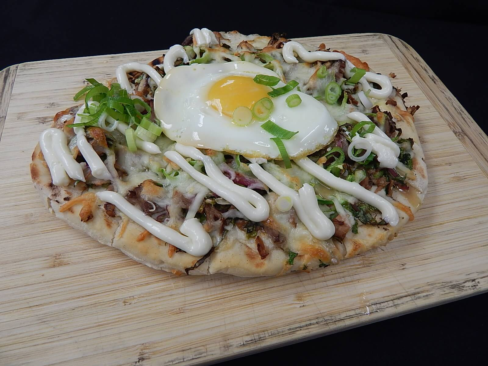 Sisig flatbread pizza the living room for Living room 101 atlantic ave boston